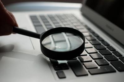 magnifying glass over laptop