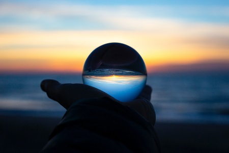 crystal ball held up to the sky