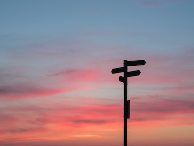 photo of sunset and signpost