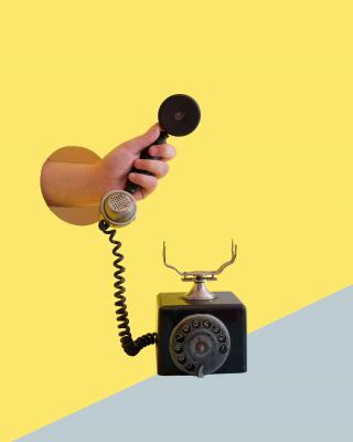 Hand offering telephone