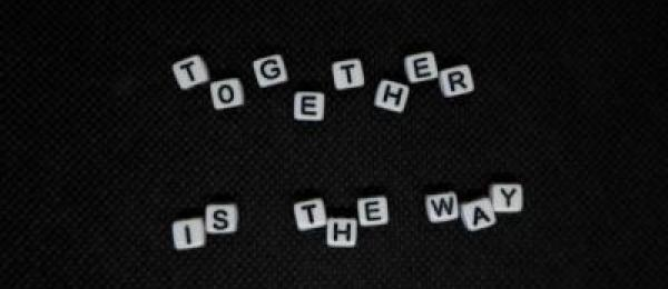Scrabble tiles spelling 'together is the way'